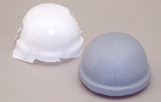 After the dome was formed, I used it to (badly) vacuum form plastic over it. The plastic was cut up to make the dome plates.