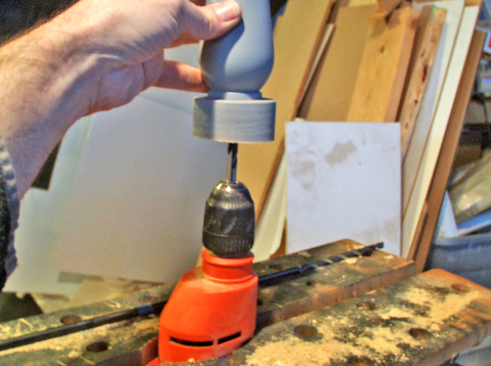 I clamped a hand drill and cored out the handle with a long drill bit.
