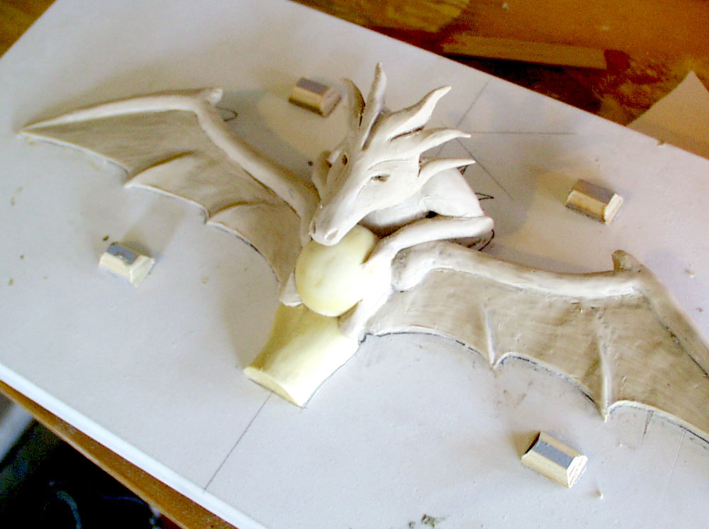 I made a quick cast of the guard area to sculpt the dragons out of clay.