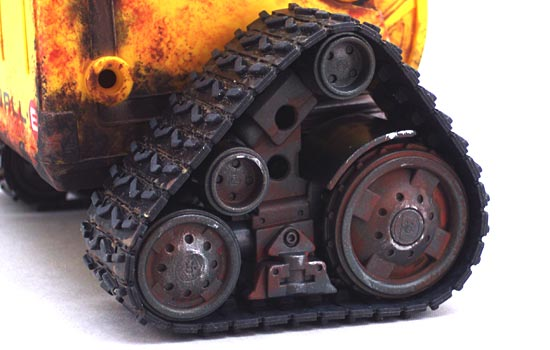 I applied washes of brown to define detail in the rubber tread and rust and silver to bring out details on the wheels.
