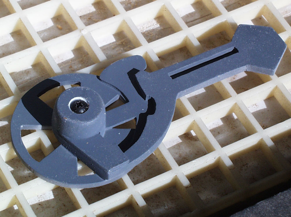 The pivot arms are made from stacked styrene sheets on a steel base.