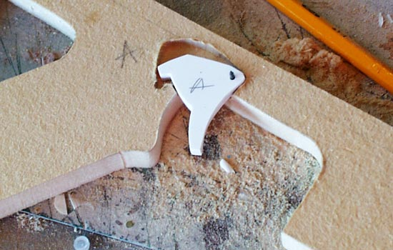 I cut the trigger from styrene and made the pivot from a nail.