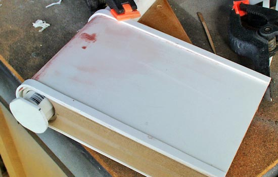 I glued on some styrene strips along the edge. The bolt insert was capped off by a styrene plate.
