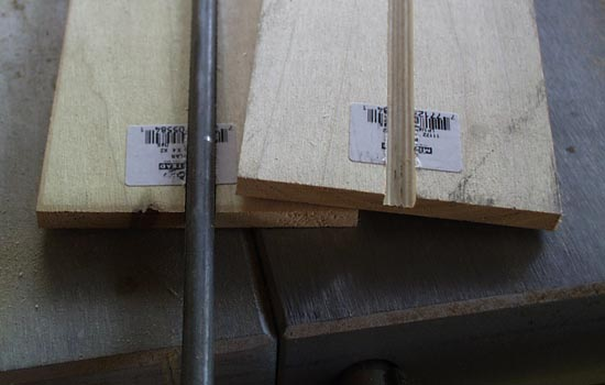 I started with the blade by cutting a groove through two sheets of 1/4″ poplar to house a 5/16″ steel rod.