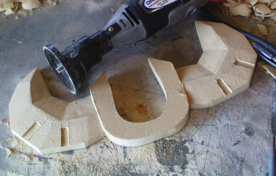 The MDF was shaped with belt sander, dremel and file to get the appropriate facets.