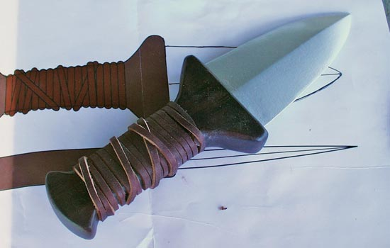 I wound the handle with a 1/4″ strip of leather, trying to capture the spirit of the original.