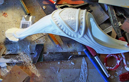 I slush cast resin in the mold to make a hollow basket guard.