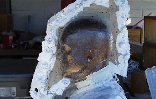 The left half of the mold removed. You can see how much clay was used to form the helmet.