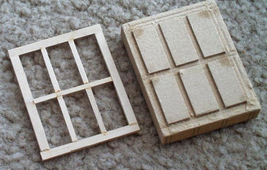 The window frames were cut from strips of 1/16″ basswood. I made a jig out of MDF so they would all turn out the same.