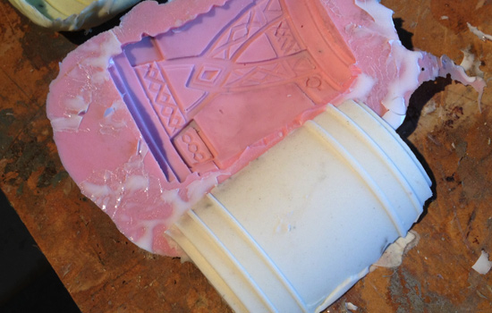 I made a mold of this pattern piece (the pink one) and a silicone positive (the white one) of the band section.