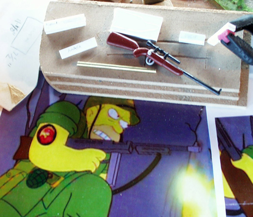 The sniper rifle from the episode was nearly identical to one that came with the figure of one of Fat Tony's mobsters. I merely repainted it.