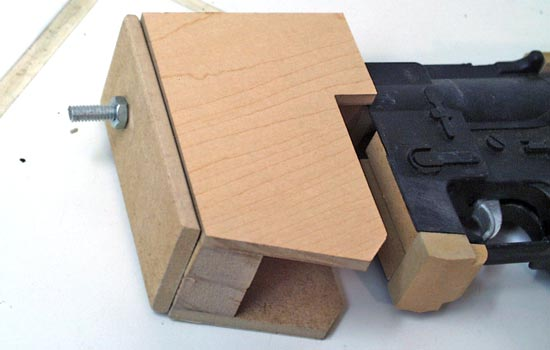 """The new magazine well was made from MDF as well as the """"plate"""" that will eventually hold the muzzle shroud. All were attached using the threaded rod (test fitted here)."""