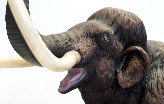 I based the painting of the mouth and trunk opening (?) on those of modern elephants, making them a pale greyish pink. The tusks were weathered with multiple washes and the eyes were painted to match a modern elephants (strange, I know).