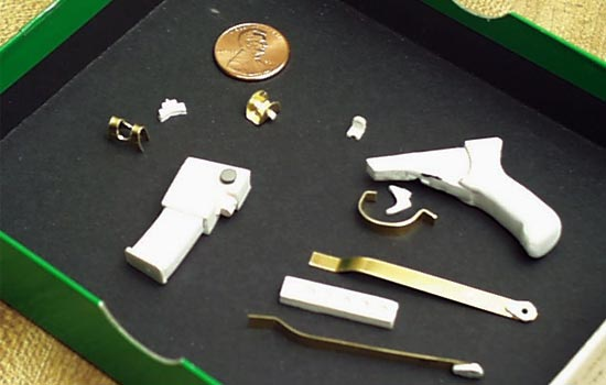 Pictured here is the completed magazine with styrene details. The front and rear sights were made from pieces of brass as were the folding stock and trigger guard. I removed the pistol grip that was molded into the Trooper's right hand so the new one could slide in. Unfortunately I couldn't attach the trigger or trigger guard until it was put in the Trooper's hand.