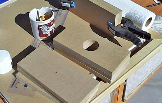 I cut sheets of 3/4″ MDF to laminate into a 9″ x 4″ x 6″ hammer head. I drilled holes through the centers of all sheets.