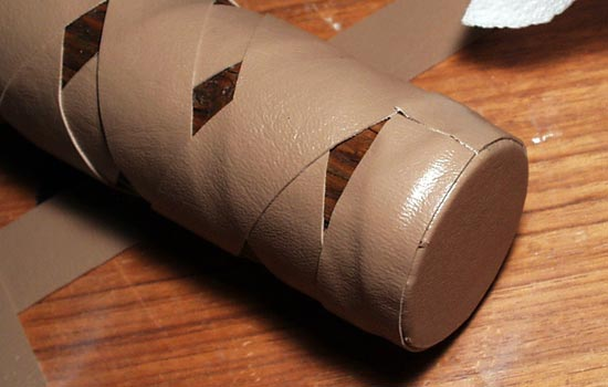 The pommel was covered with a circular piece of vinyl, glued over the edges and then wrapped with more vinyl strapping.