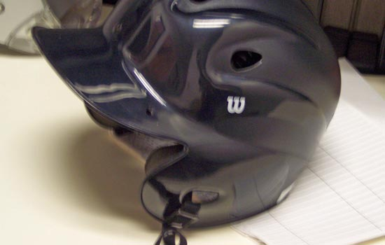 I started with a basic batting helmet. I found one that was a bit small on my enormous melon so that when the final helmet is complete I wouldn't look like a bobble-head. I tore out all the padding so I could add it later once I saw how the final helmet fit.