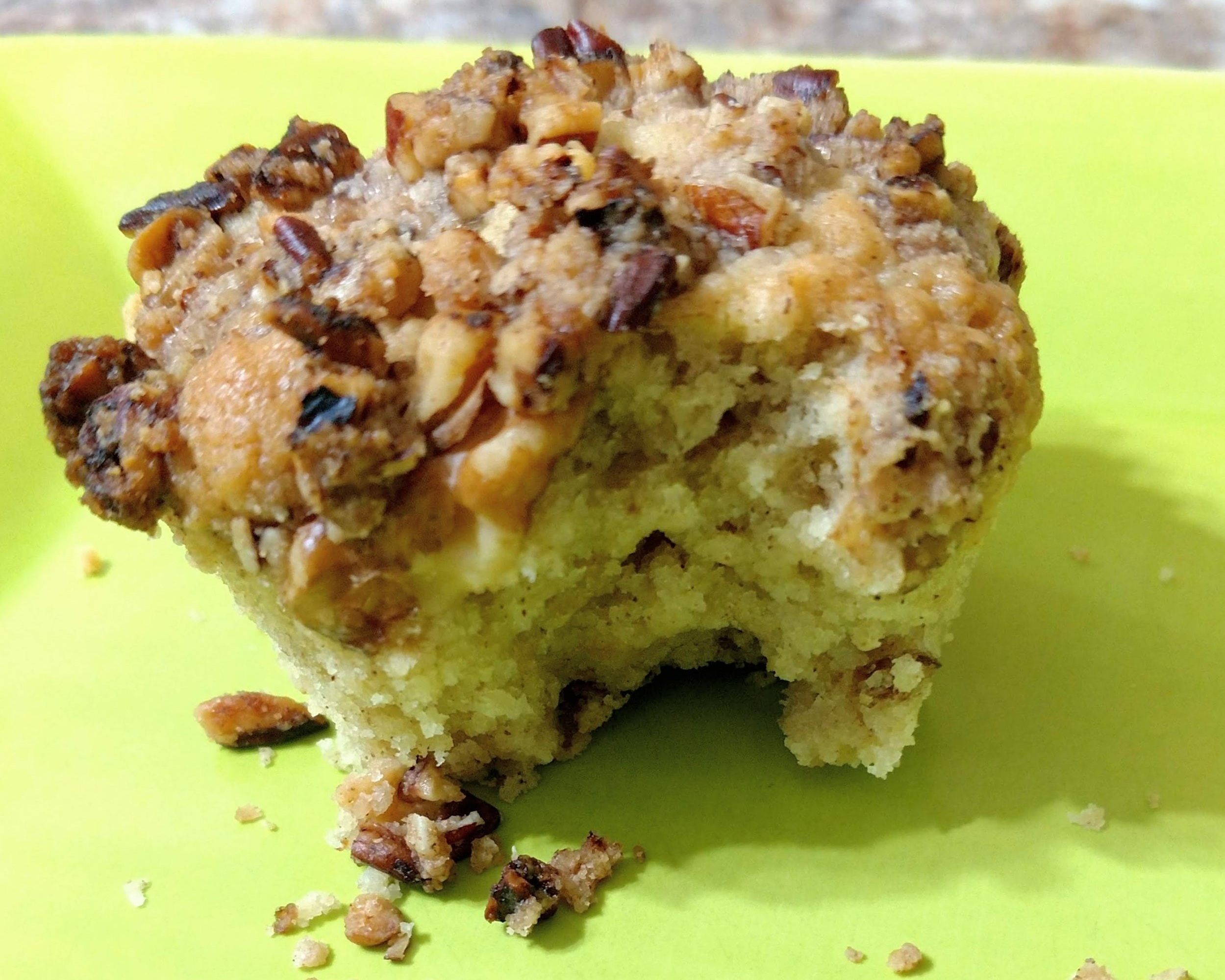 Banana Nut Muffin - Topped with a crunchy pecan streusel and filled with chopped walnuts!