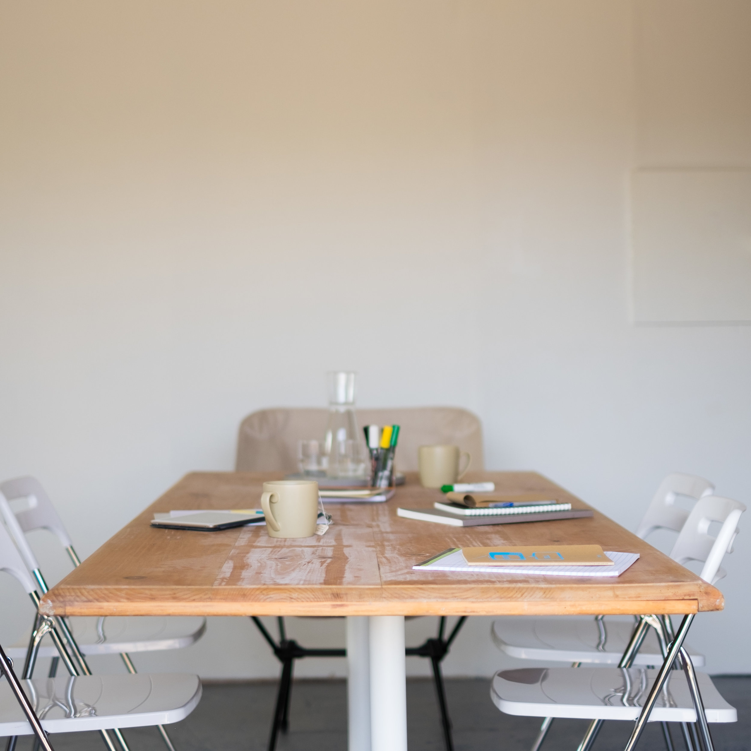 Meeting Space - Get away from distractions and host your next brainstorming session, kickoff meeting or strategy think tank at Offsite. We have a conference table, chairs, huge white board, A/V gear and can arrange all the food + comforts you'll need.