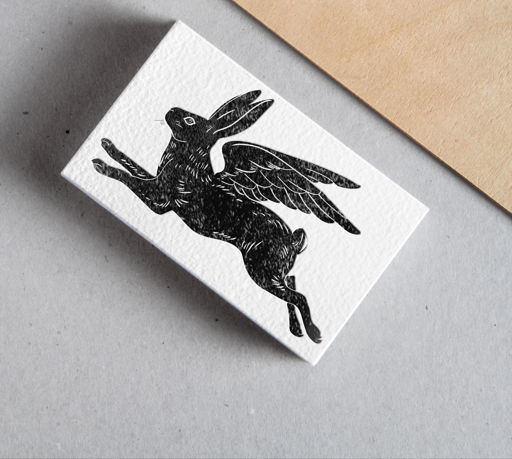 The winged rabbit is a symbol of the power of gentleness and grace. It leaps ahead, body fully extended, eyes and ears alert and attentive but without fear. In homage to famed designer Eric Gill's Pegasus for  Poetry Foundation , although the logo is done up as a vector, it is treated to resemble a wood-cut texture.