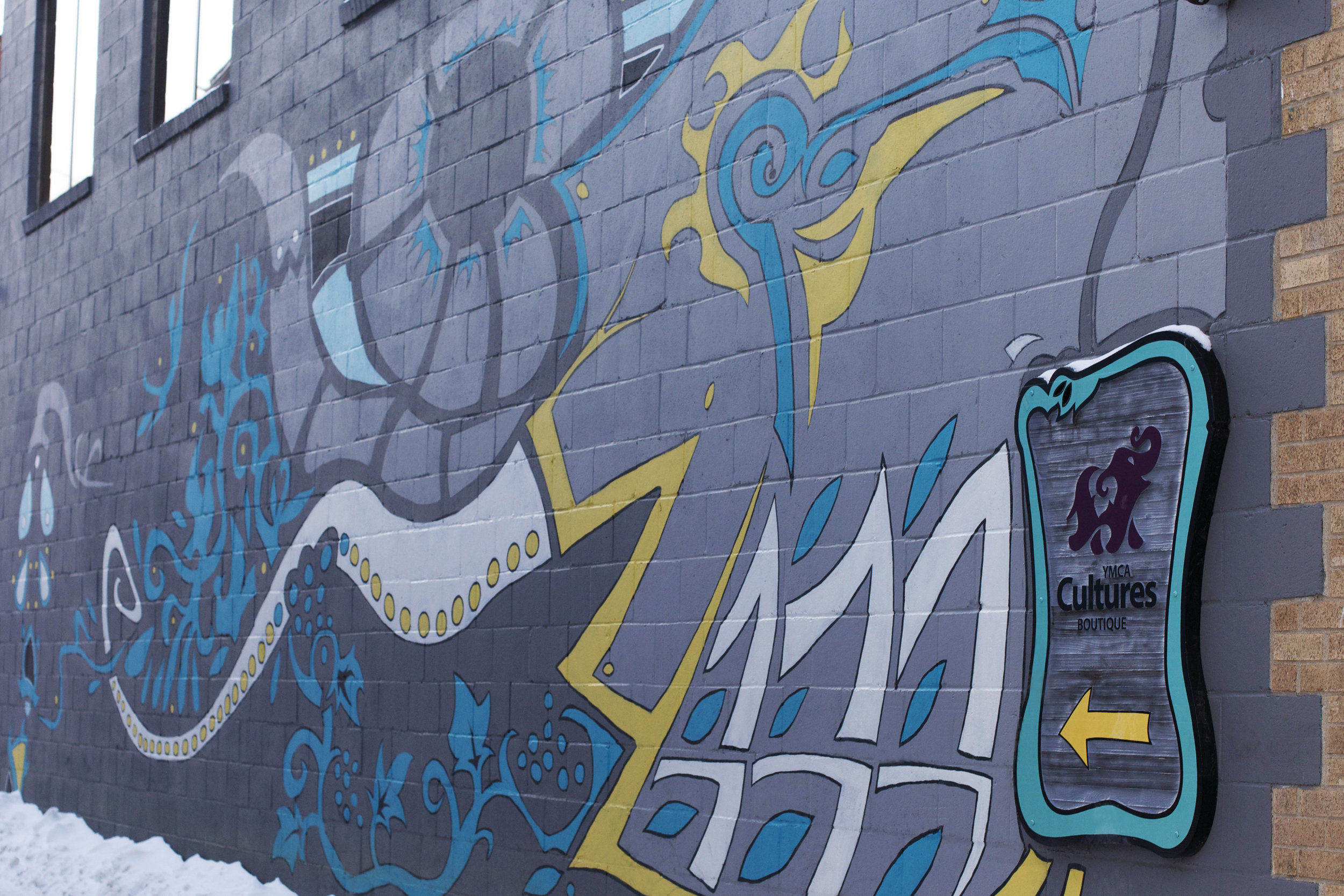 cultures-sign-and-grafitti-wall.jpg