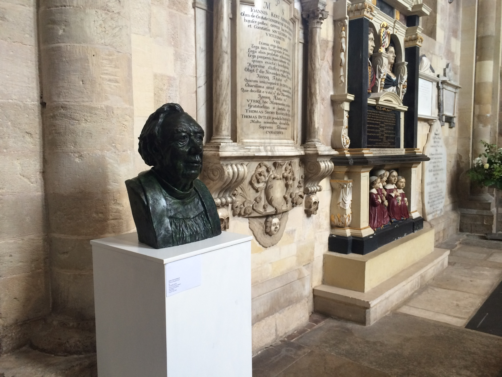 Trevor Beeson, former Dean of Winchester Cathedral. By Melanie Legge. This was selected by the Society of Portrait Sculptors for their exhibition, FACE2016 and is here exhibited at Romsey Abbey.