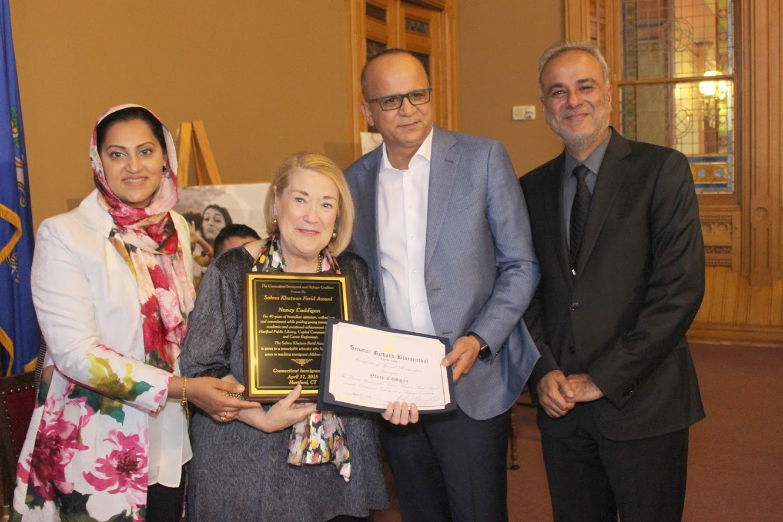Award recipient Nancy Caddigan with Tariq & Asma Farid and State Sen. Saud Anwar