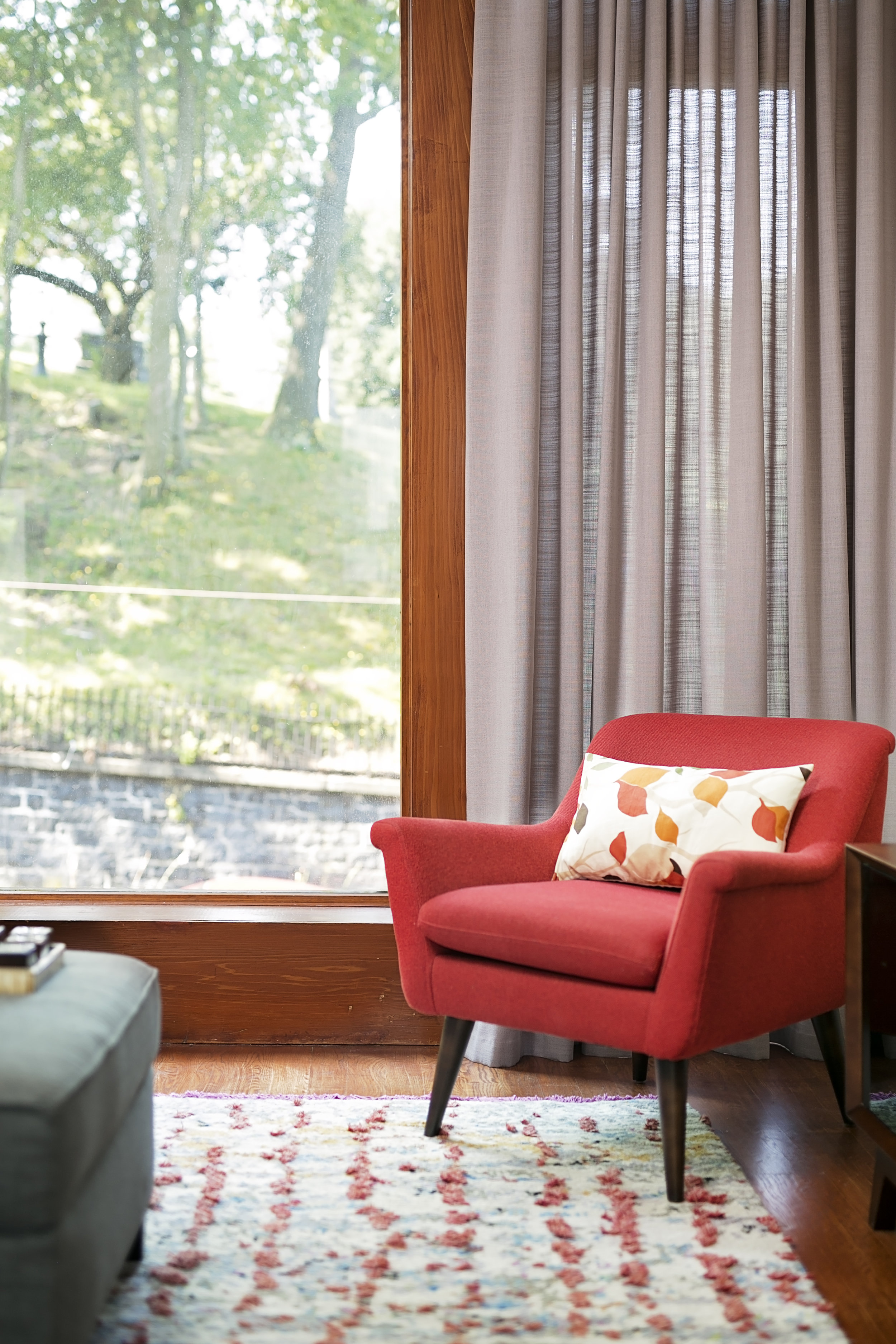 Red-Living-Room-Armchair-Overlooking-Park.jpg
