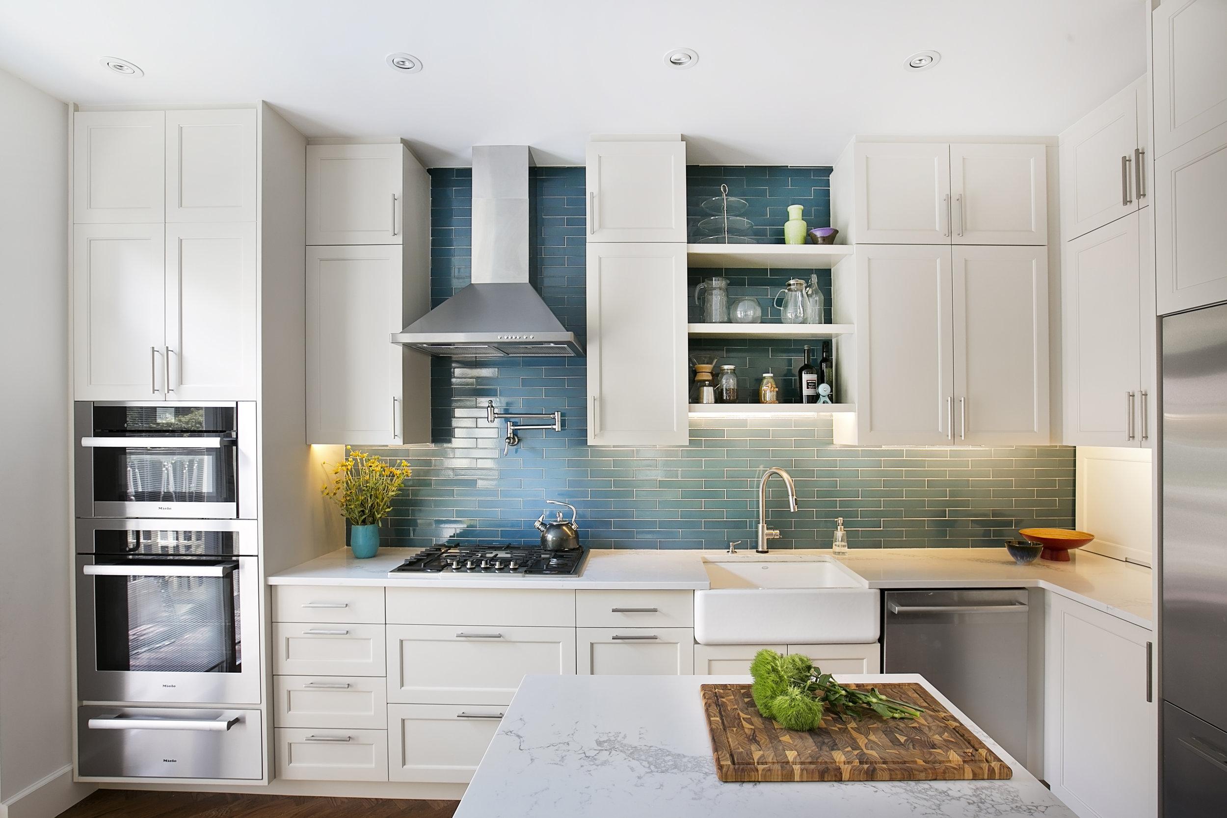 Blue-Tile-White-Cabinets-Modern-Luxury-Kitchen.jpg