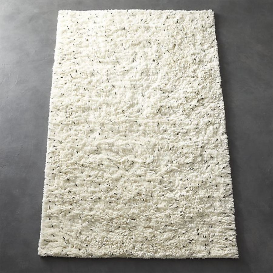 The  Confetto Rug  from CB2 is a fresh take on the shag rug. Peppered with black hides dirt and creates welcome contrast. Image via  cb2.com
