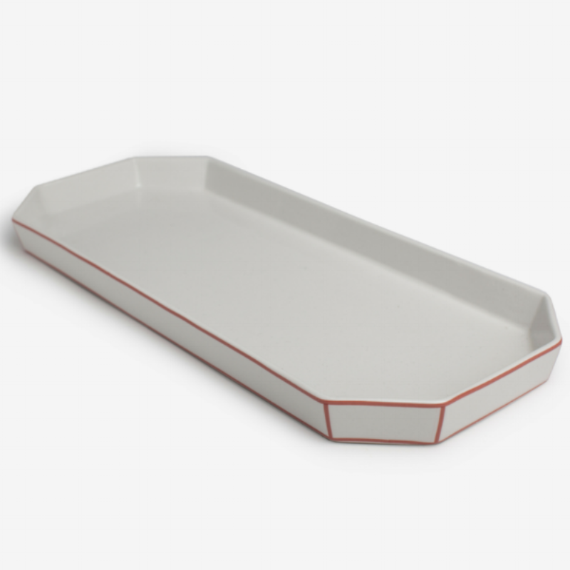 This retro-inspired, porcelain  Boudoir tray by Odeme , available at Burke Decor comes in a variety of sizes and edge colors. We love the coral option pictured!