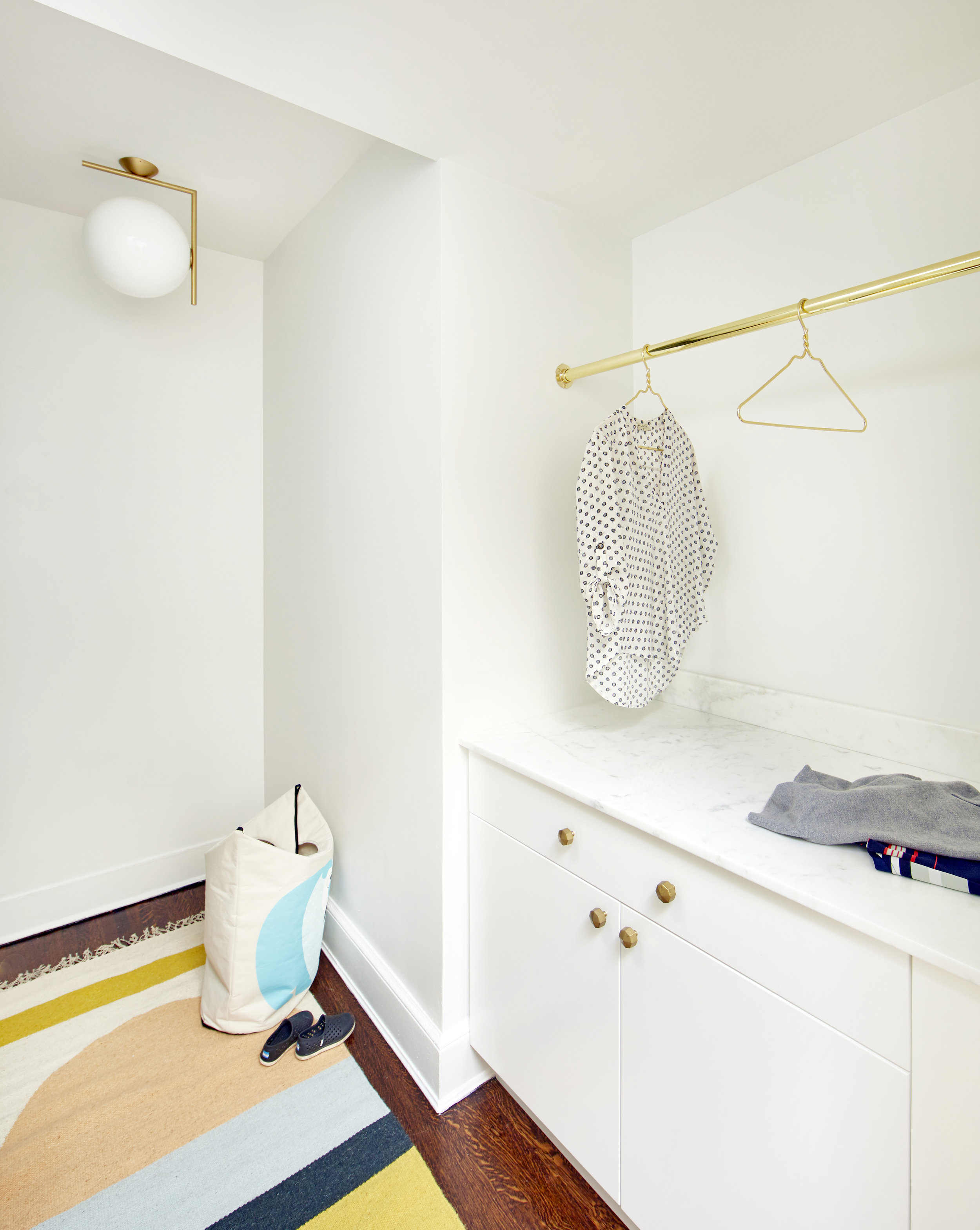 Combo laundry room / walk-in closet in our  'Carroll Street Cool'  project.