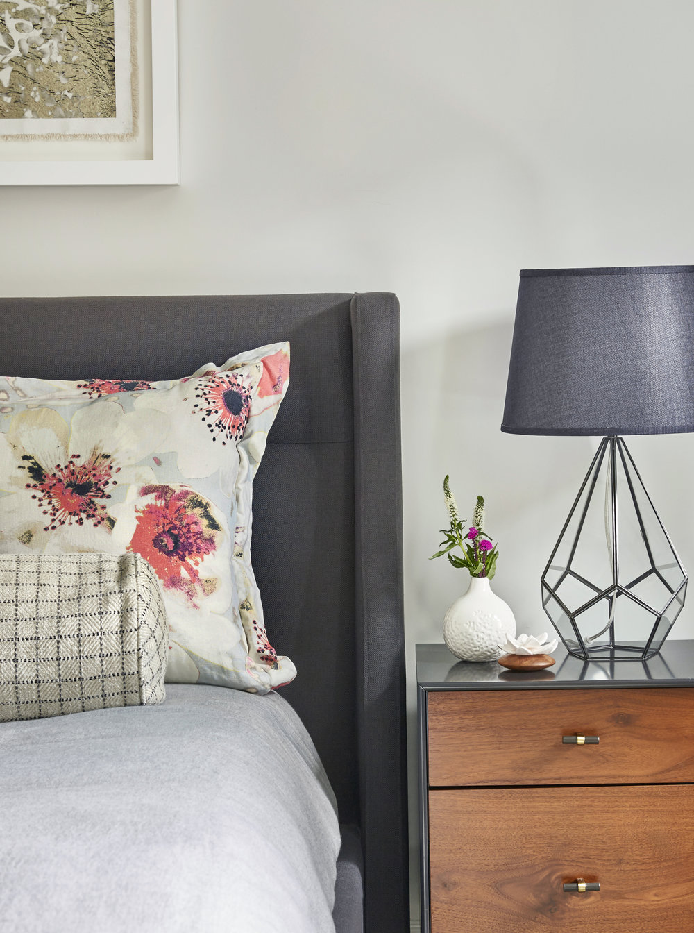 A traditional modern bedroom in grey hues with floral pops, part of our ' Fresh, Fantastic and Fun on 1st Street ' project.