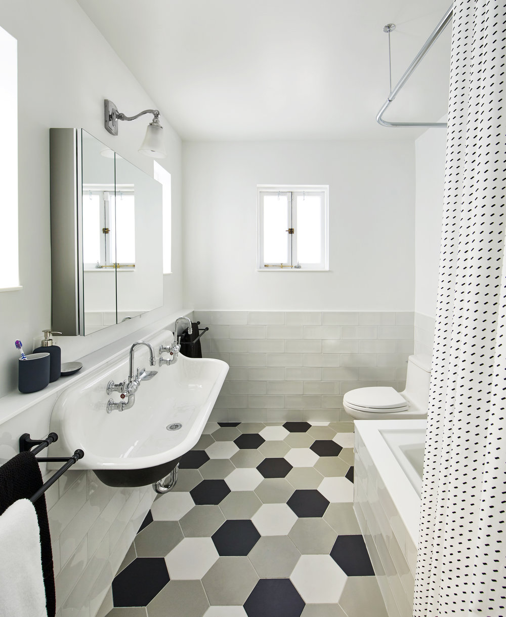 A black and white, double farmhouse sink by  Kohler  play off of  Adko  Hexagon tiles for a perfect transitional, modern look in our  Carroll Street Cool  project.