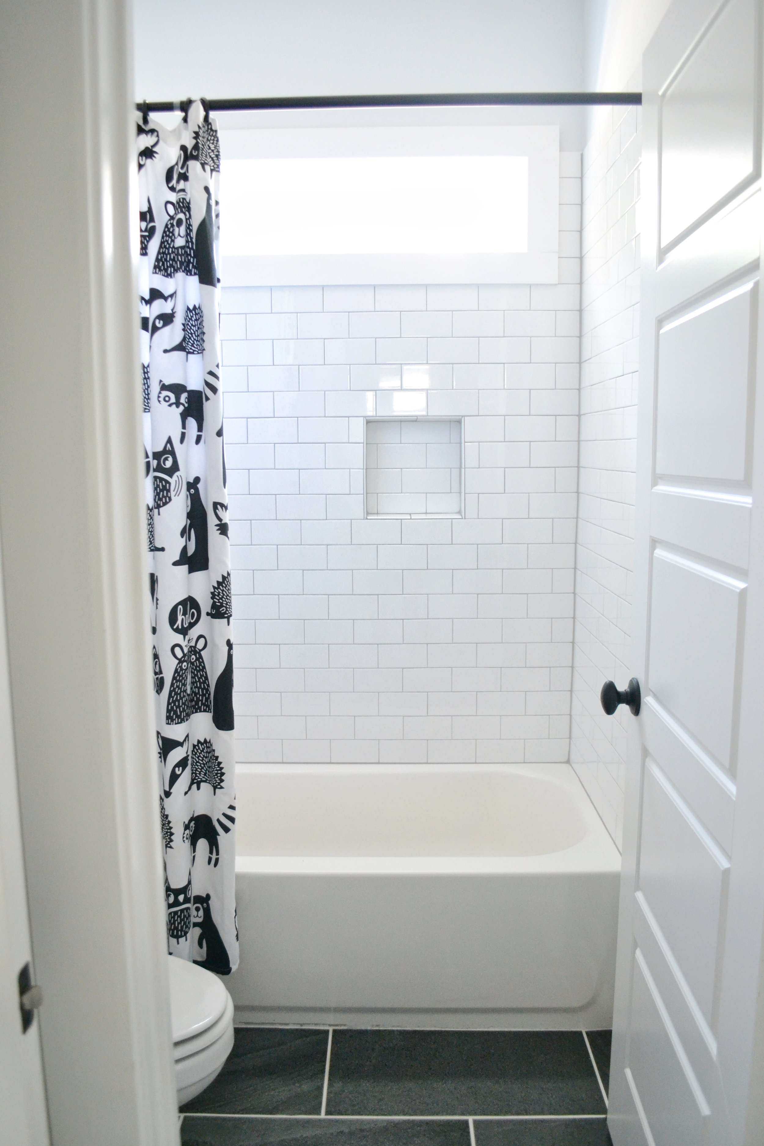 A Black and White Shared Bathroom