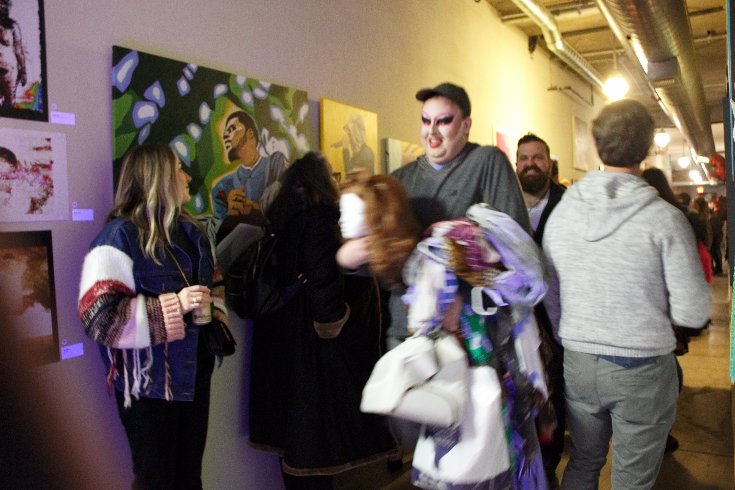Host Mark Mayr scurries through, wardrobe in hand, Nick McClanahan of House of Iconoclasts following closely behind