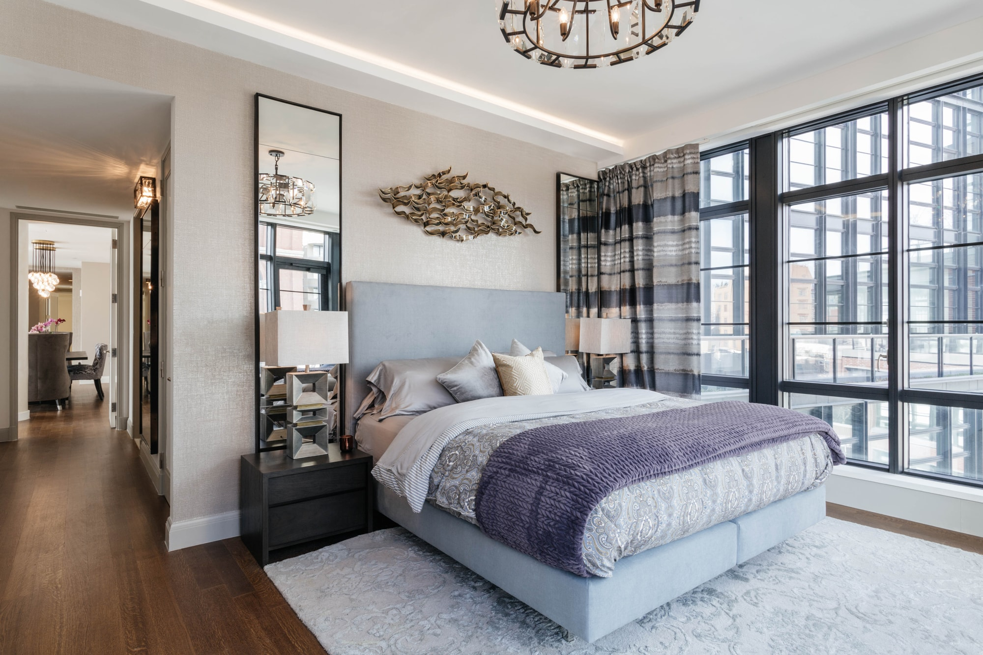 Bright bedroom with soft carpet and luxurious furnishings