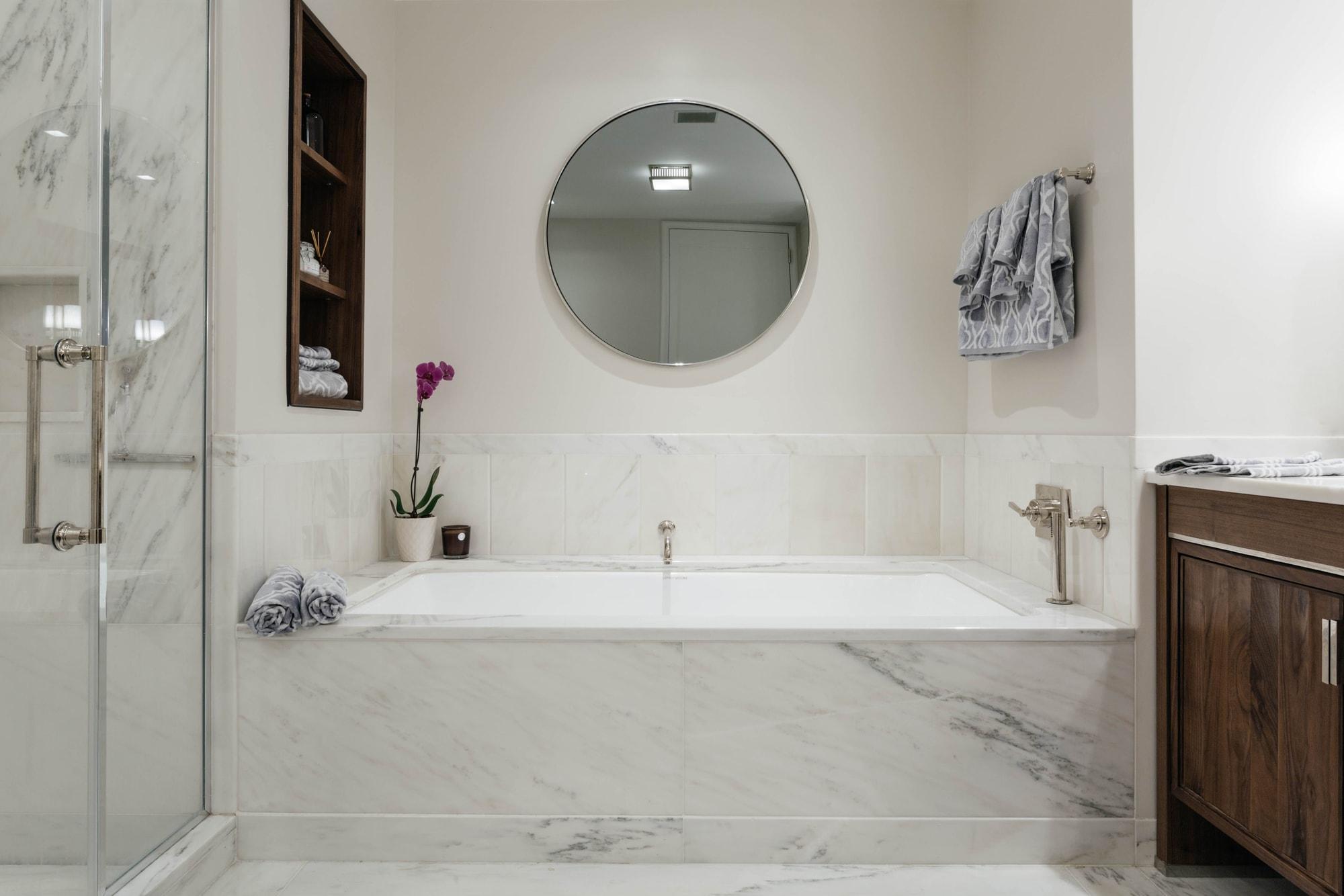 Modern marble bathtub and walk in standing shower
