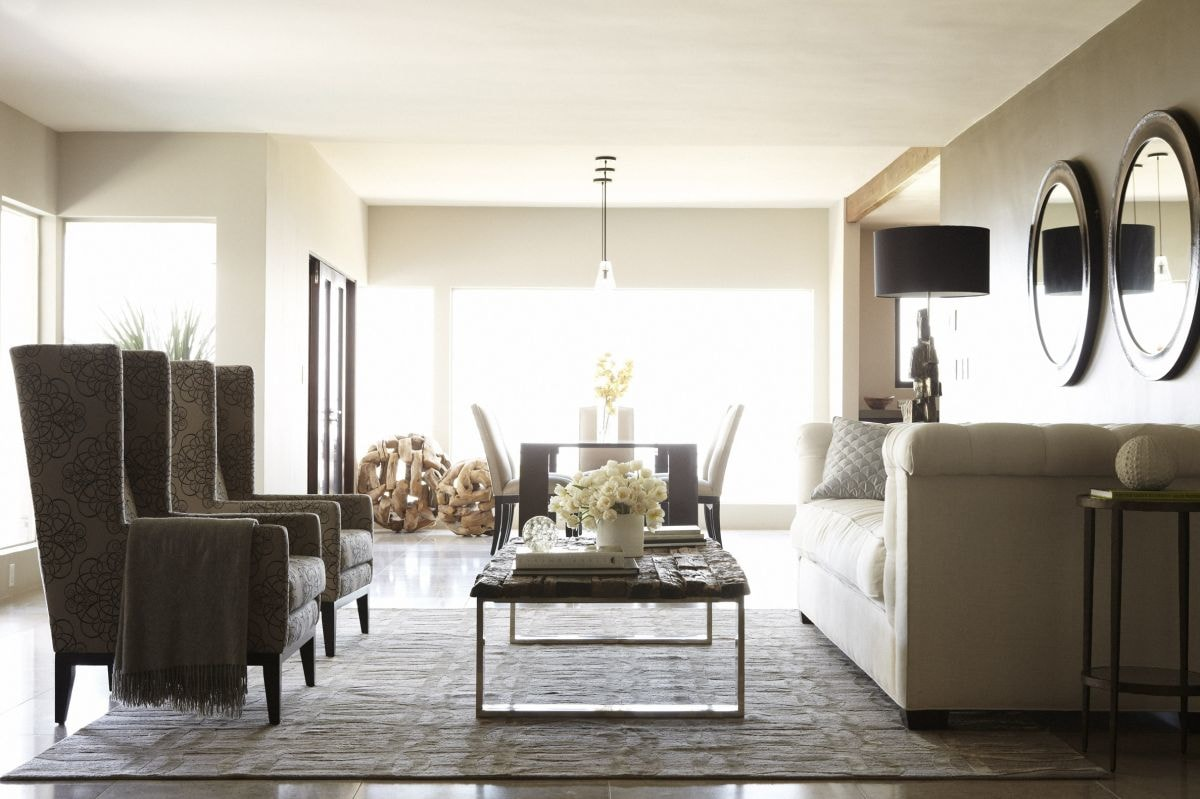 Bright living room space with high backed chairs and coffee table