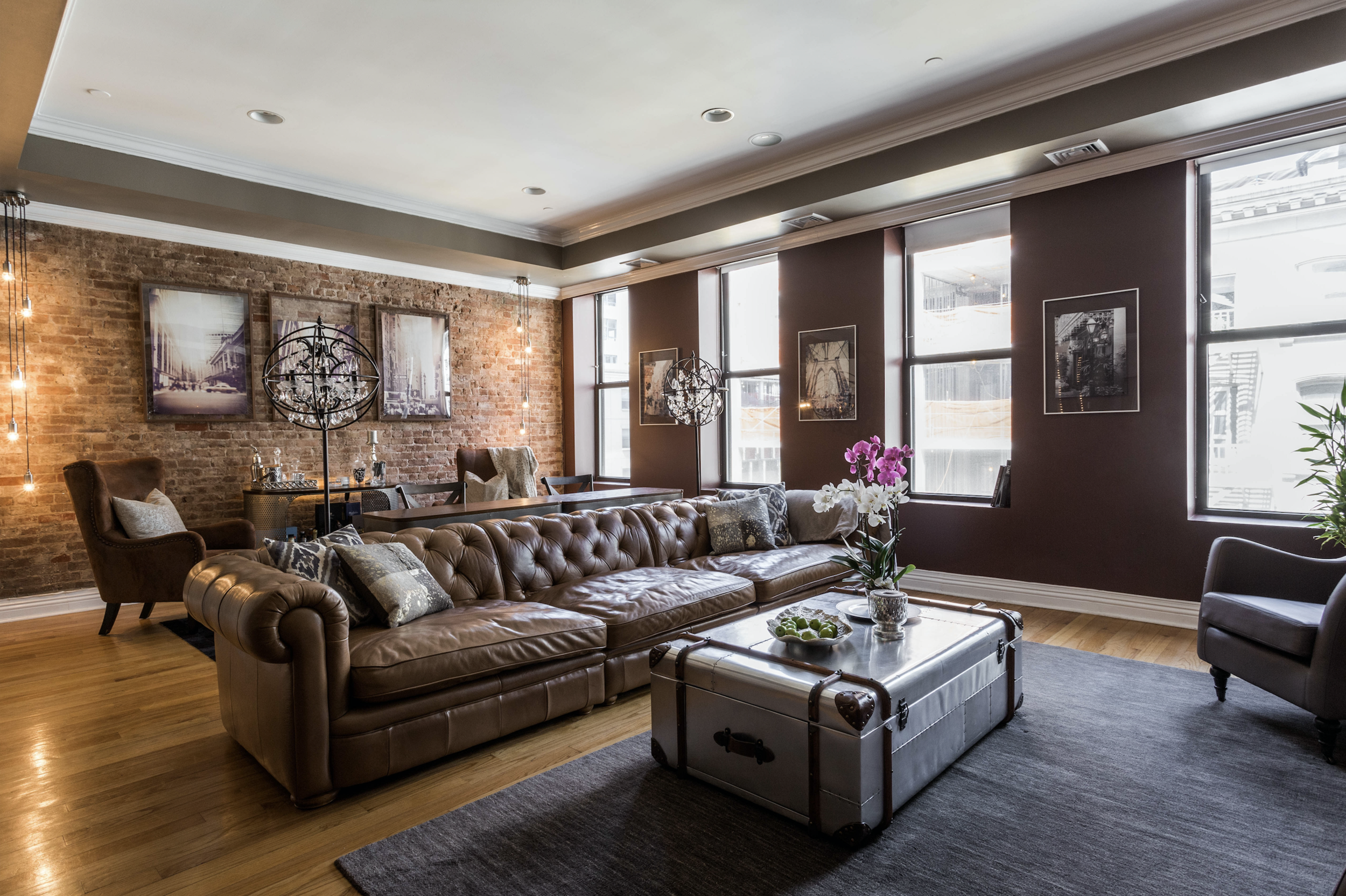 Stylish living room with dark brown leather sofa
