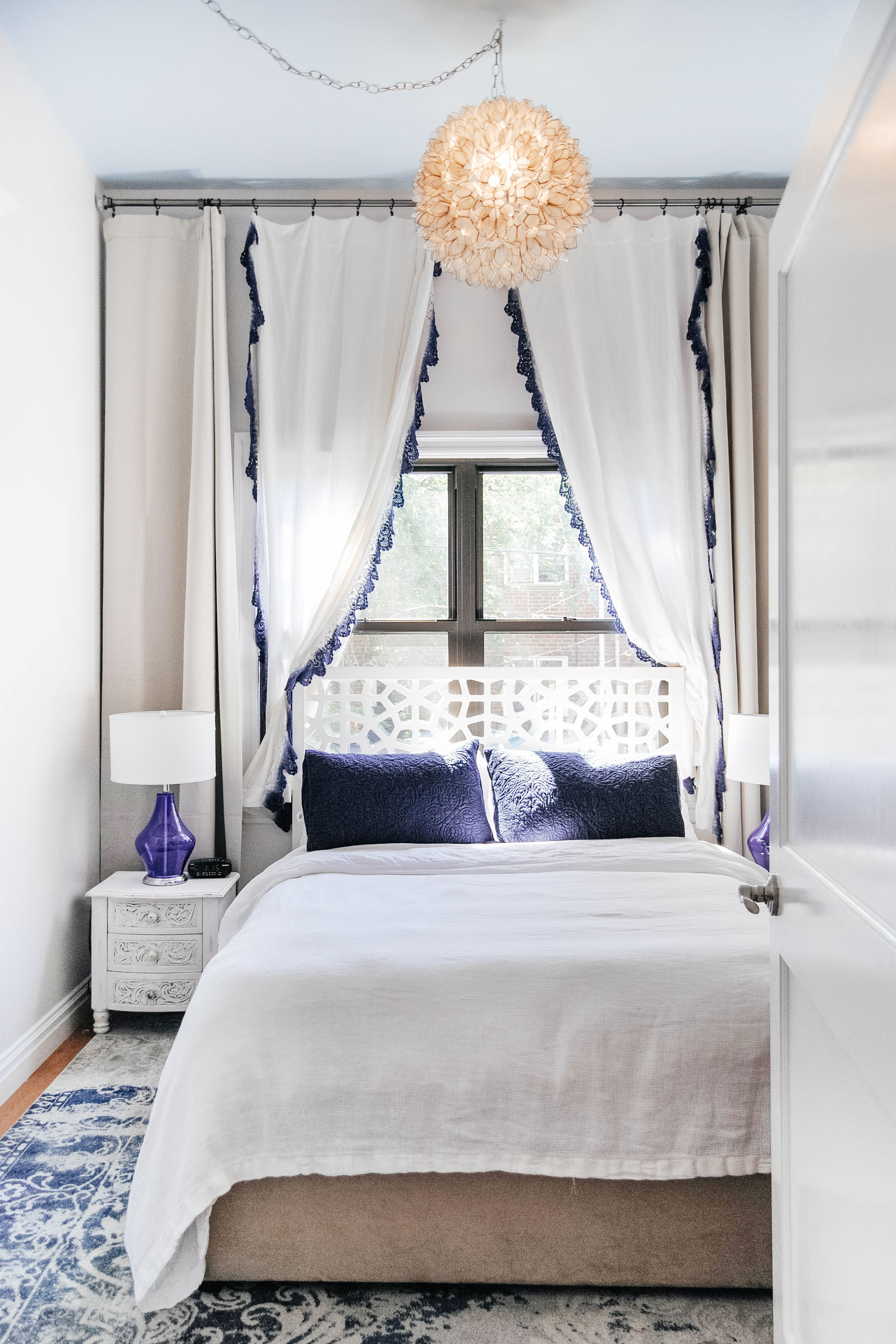 Bedroom with delicate window coverings