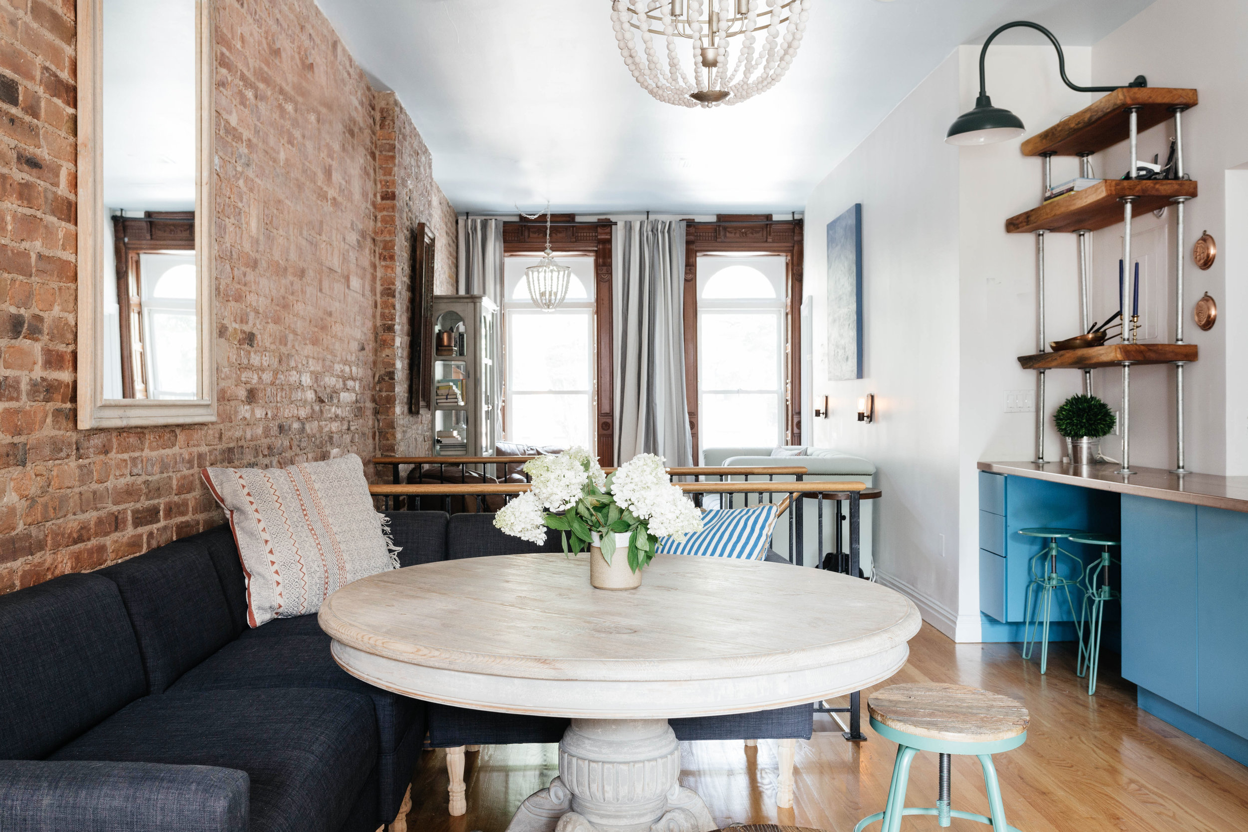 Living space with round wooden table