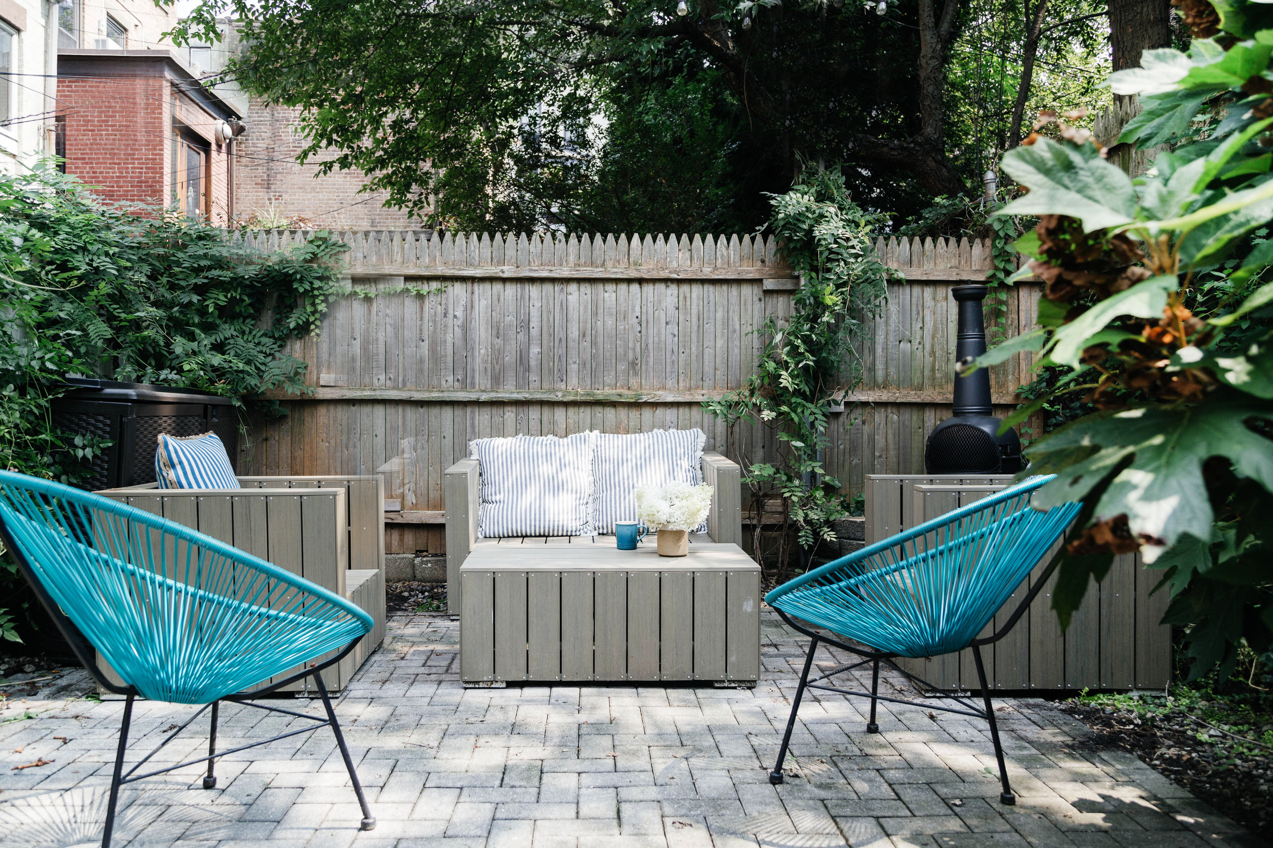 Outdoor seating area with blue chairs