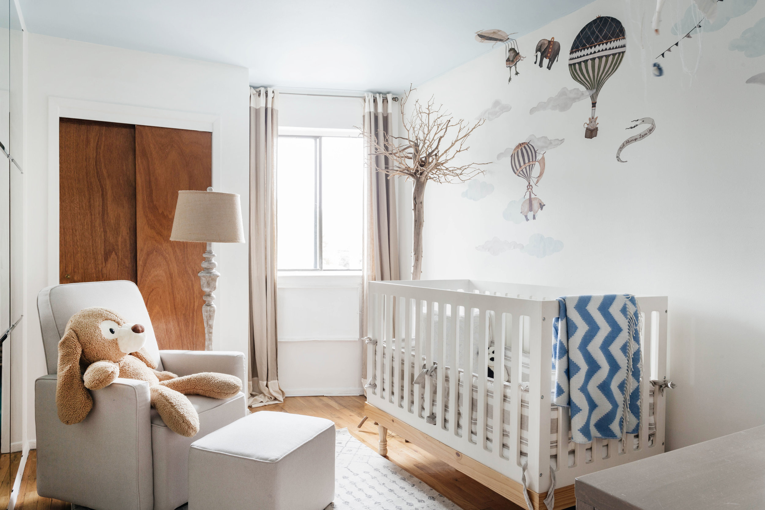 Baby's room with custom basket shelves mounted on wall