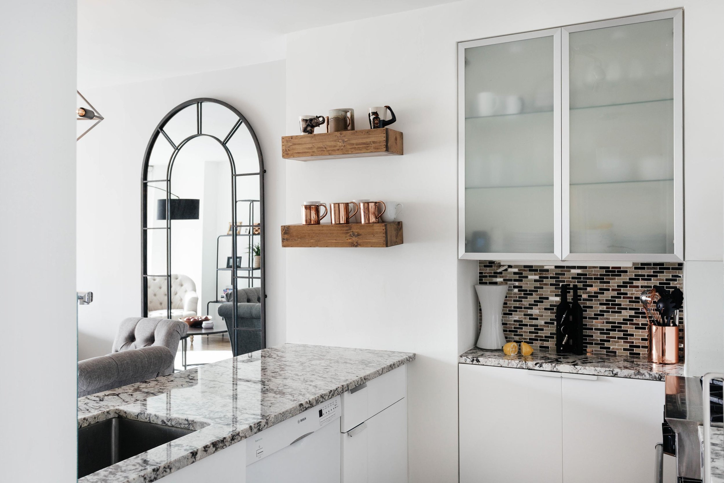 Kitchen area with grey marble counter top