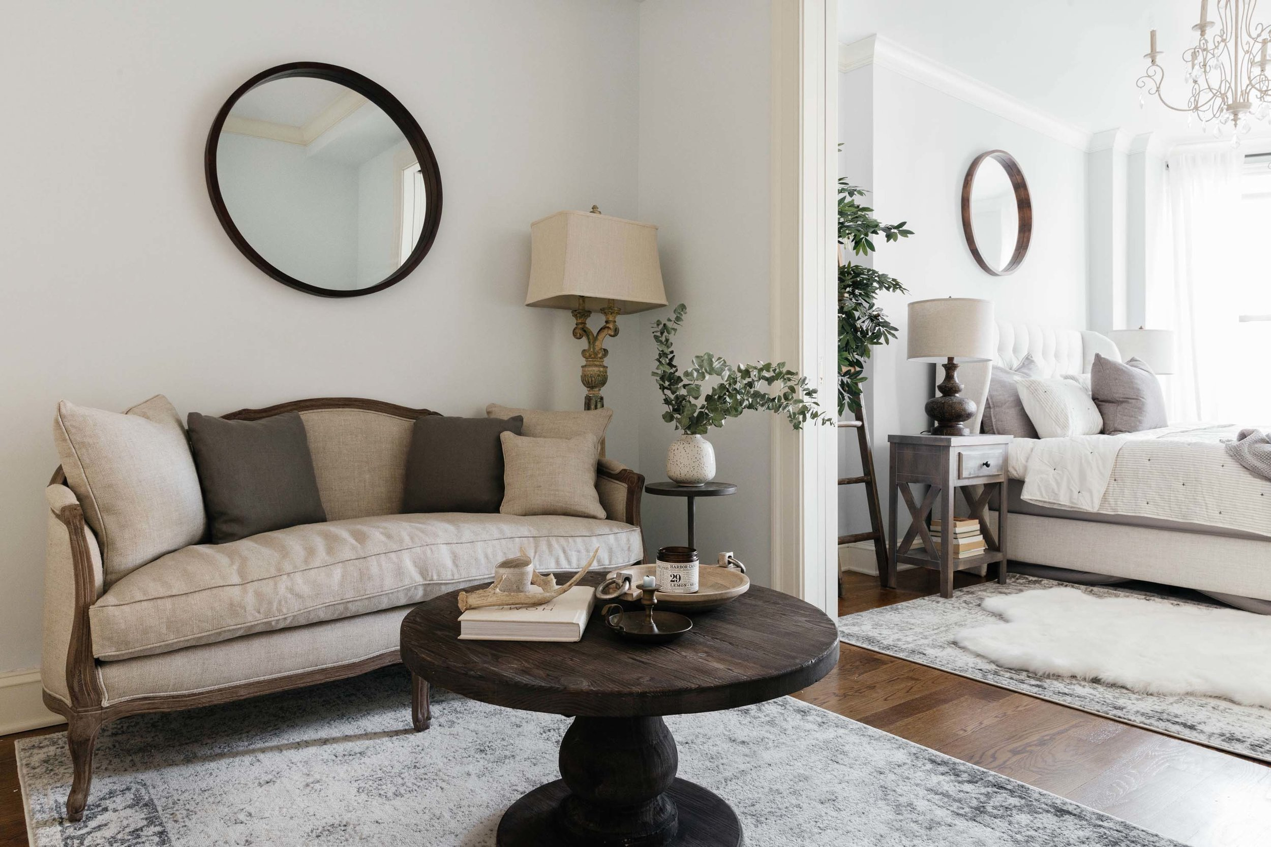 Townhouse living room area with beige colored furniture