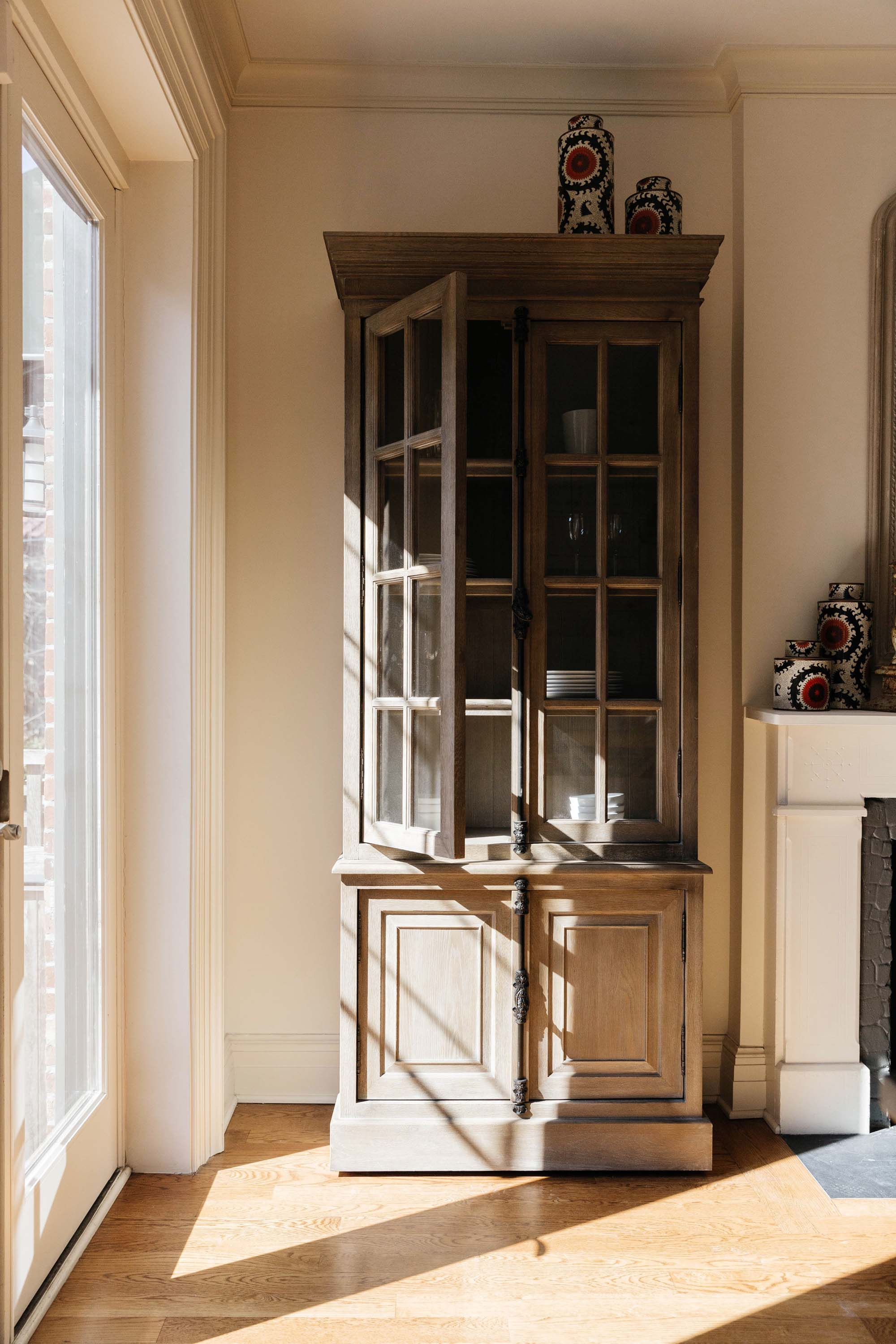 Tall rustic cabinet with dishes inside