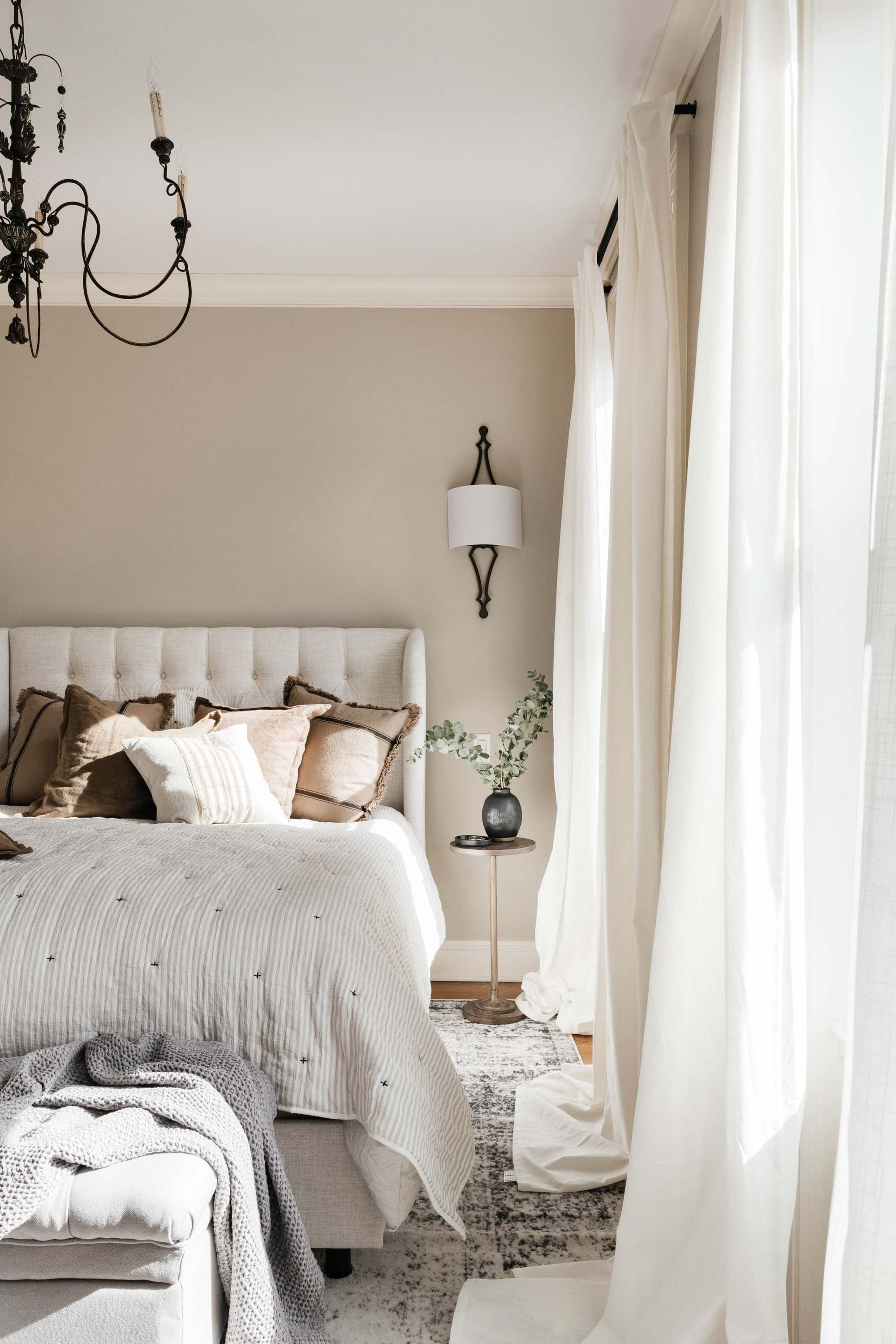 Bedroom with light window drapes