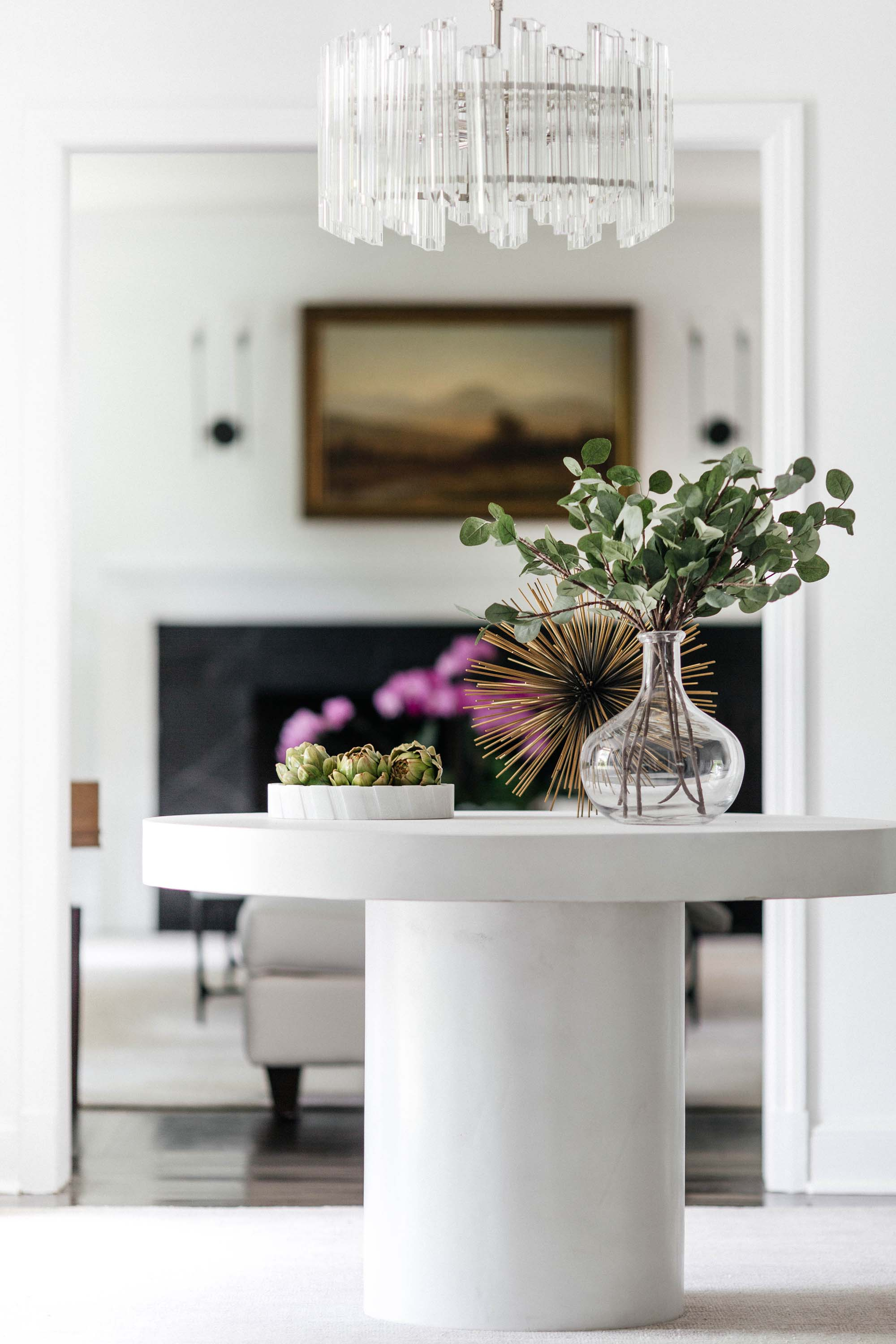 House interior with white round table and plants on top