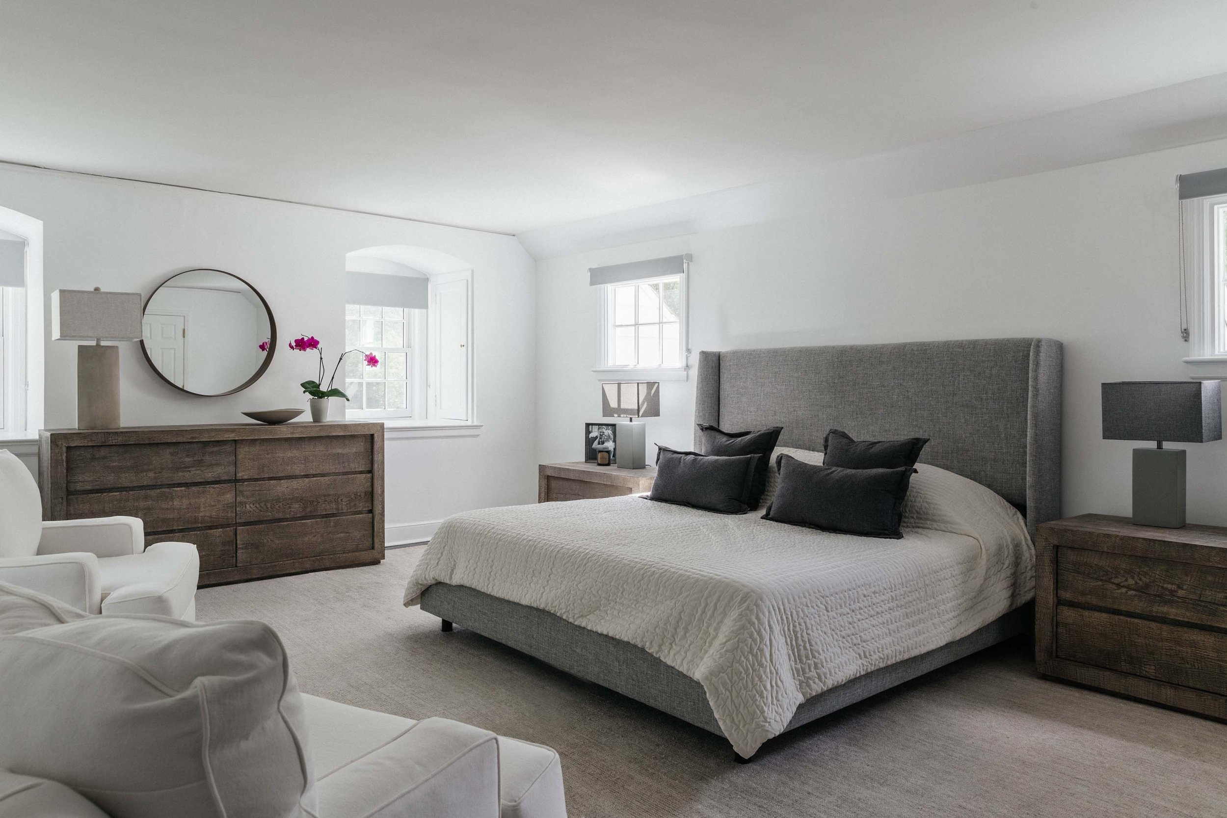 Modern bedroom with bed, bedside table and white painted walls